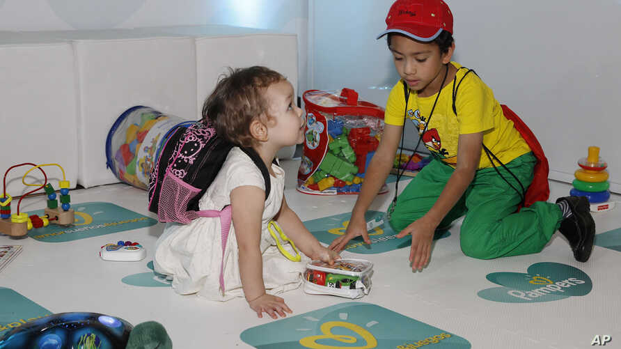 """Kids play at the Pampers """"Love, Sleep & Play"""" launch event"""