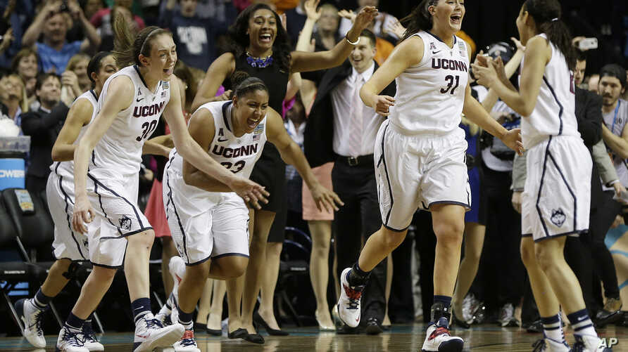 Connecticut players leave the bench after the second half of the championship game against Notre Dame in the Final Four of the NCAA women's college basketball tournament, Tuesday, April 8, 2014.