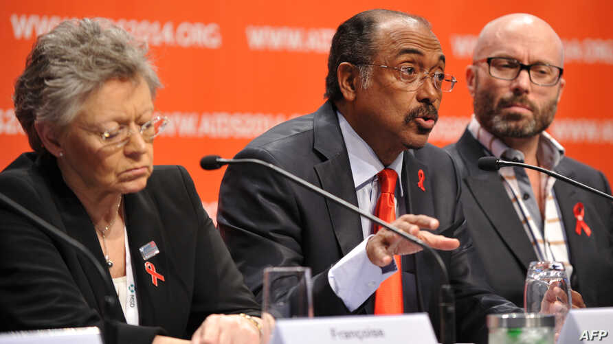 UNAIDS Executive Director Michel Sidibe from Mali (C) speaks at a press conference alongside President of the IAS, Francoise Barre-Sinoussi from France (L) and local CPC co-chair Brent Allan in Melbourne, July 20, 2014.