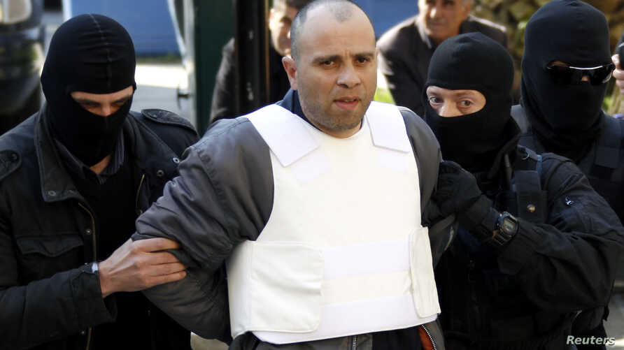 FILE - Nikos Maziotis (C) is escorted by policemen to a prosecutor's office in Athens April 12, 2010.