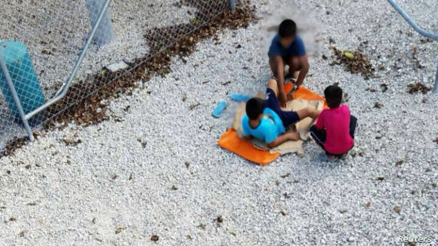 An undated supplied image from Amnesty International claiming to show children playing near a fence at the country's Australian-run detention centre on the Pacific island nation of Nauru.