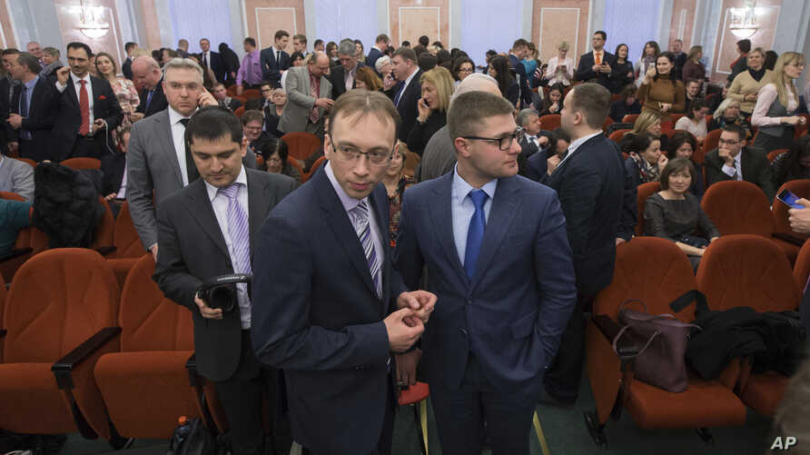FILE - Jehovah's Witnesses wait in a courtroom in Moscow, Russia, April 20, 2017. Russia's Supreme Court has banned the religious group from operating in the country.
