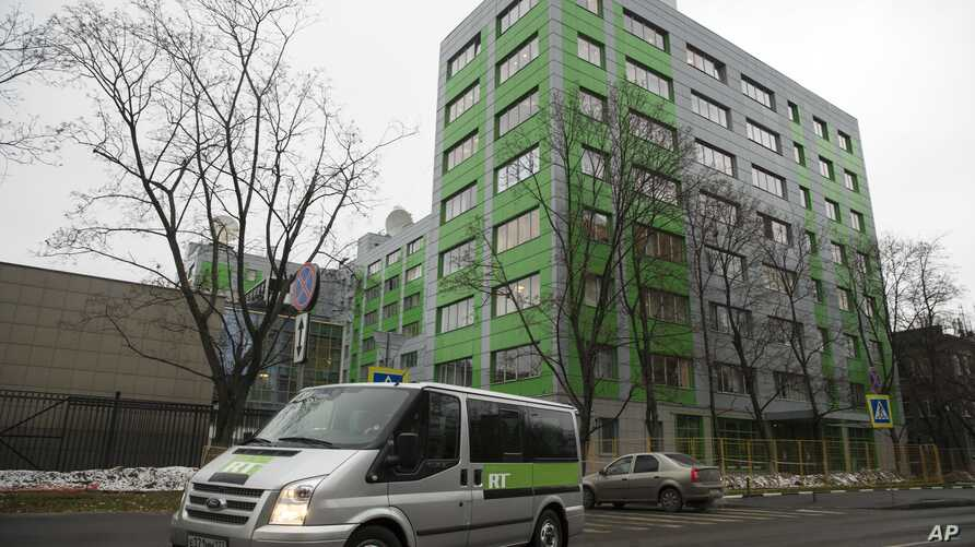 FILE - In this file photo taken Oct. 27, 2017, a car of Russian state-owned television station RT passes by the company's office in Moscow.
