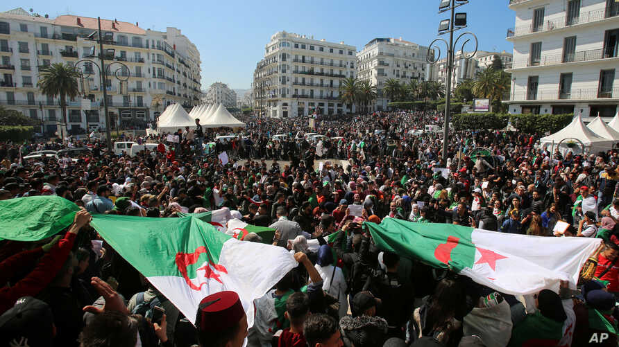 People take part in a protest demanding immediate political change in Algiers, Algeria, March 12, 2019.
