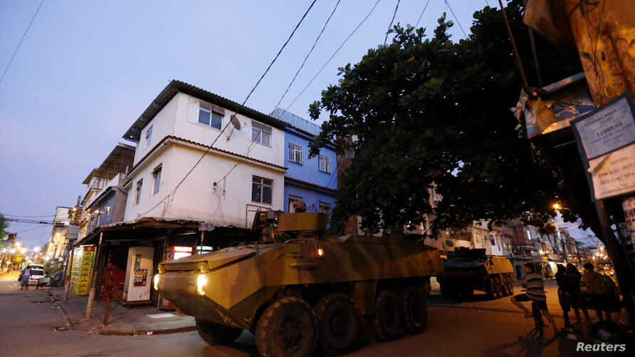 Brazilian Marine's armored vehicles patrol the Mare slums complex in Rio de Janeiro, March 30, 2014. The federal troops and police occupied the Mare slums complex on Sunday to help quell a surge in violent crime following attacks by drug traffickers