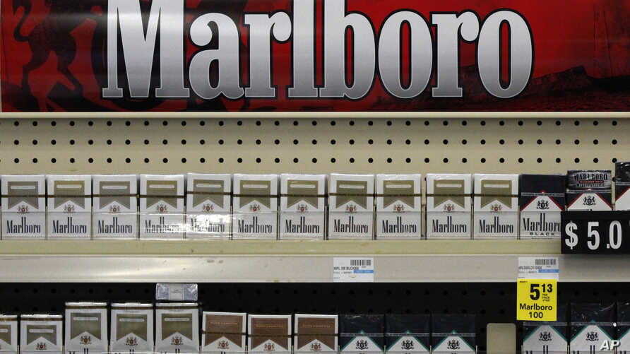 FILE - In this July 17, 2013 file photo, Marlboro cigarettes are on display in a CVS store in Pittsburgh. The second largest drug store chain in the U.S. has stopped selling tobacco products.