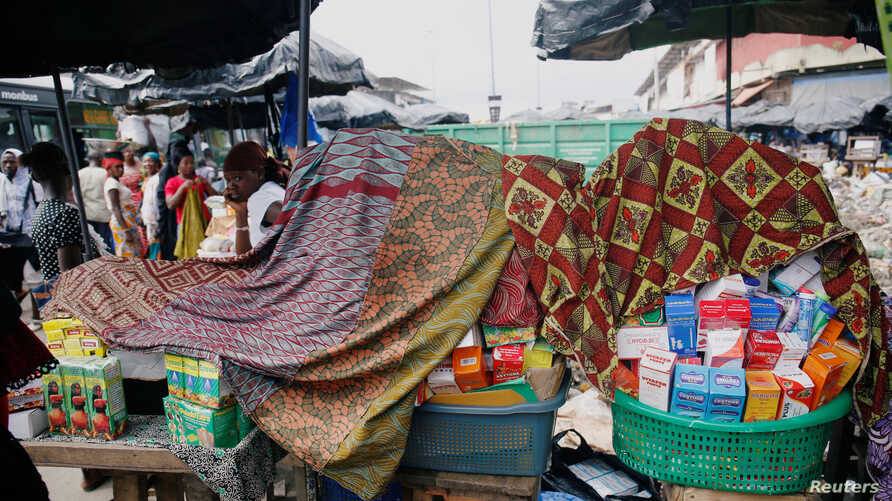 FILE - A street vendor sells illegal and false drugs in a street of Adjame in Abidjan, Ivory Coast, Oct. 13, 2018.