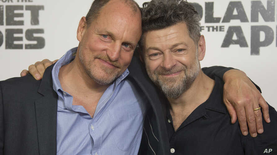FILE - Actors Andy Serkis, right and Woody Harrelson pose for photographers upon arrival at the screening of the film 'War for the Planet of the Apes' in London, June 19, 2017.
