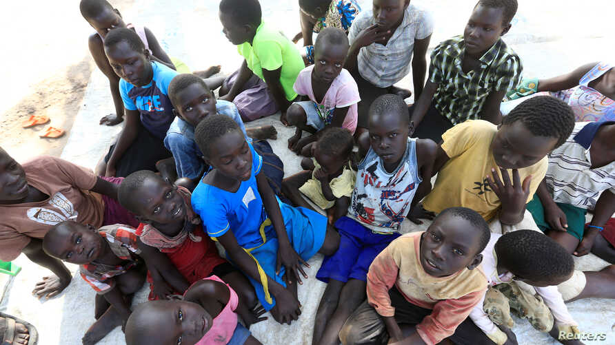FILE - Displaced orphans from South Sudan gather at Palorinya settlement camp in Moyo district northern Uganda, Oct. 28, 2017.