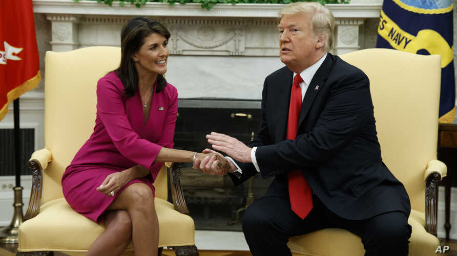 President Donald Trump meets with outgoing U.S. Ambassador to the United Nations Nikki Haley in the Oval Office of the White House, Oct. 9, 2018, in Washington.