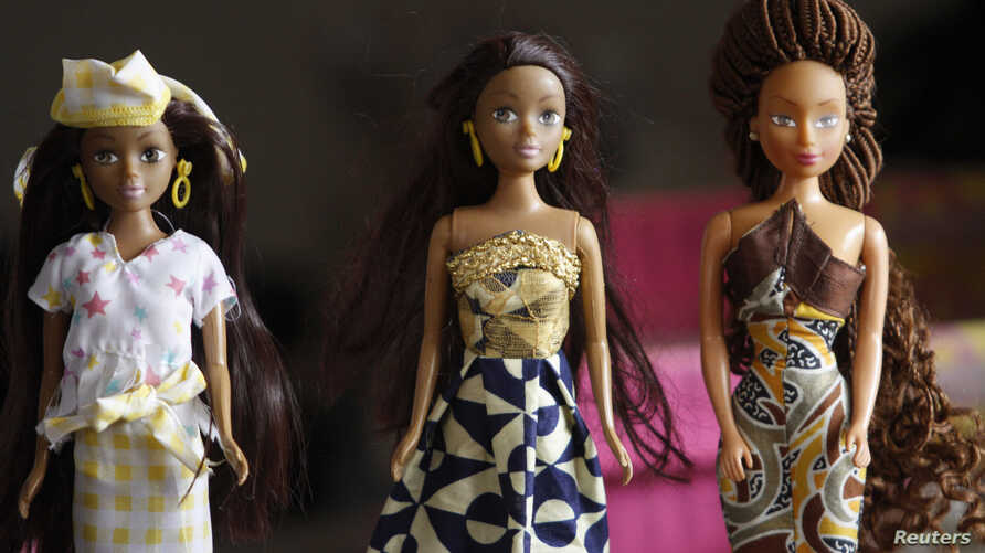 Dolls dressed in local attire are arranged on a table at a workshop in Surulere district, in Nigeria's commercial capital Lagos January 8, 2014.  With a booming economy in Nigeria and more black children than anywhere else in the world, Taofick Okoya