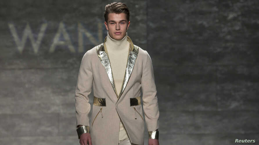 A model presents a creation from the Son Jung Wan 2014 Fall/Winter collection during New York Fashion Week in New York, Feb. 8, 2014.