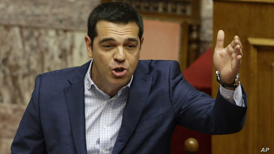 Greek Prime Minister Alexis Tsipras answers opposition questions in parliament in Athens, July 31, 2015.