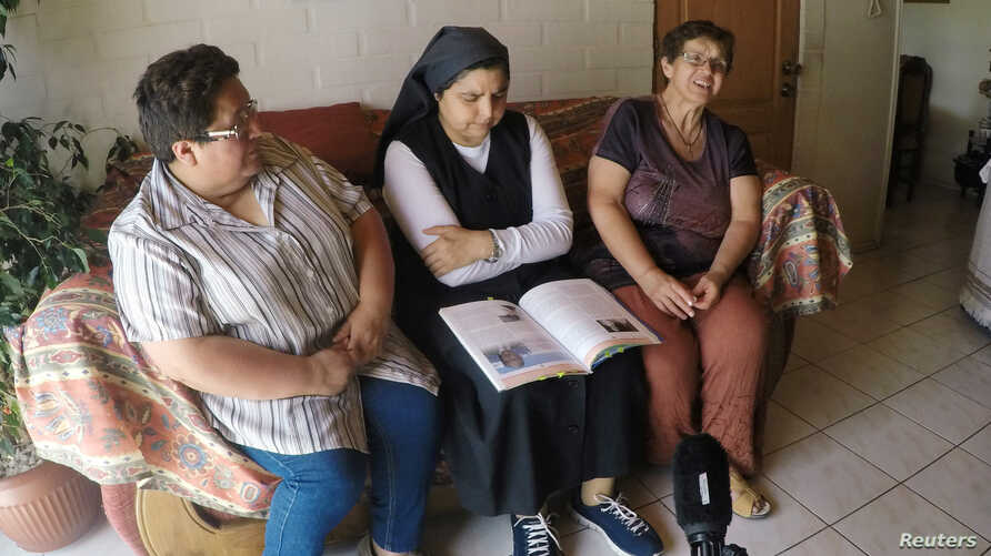 Former nuns Marcela Quitral, Yolanda Tondreaux and Eliana Macias, from the Sisters of the Good Samaritan order, attend an interview with Reuters in Talca, Chile, Feb. 15, 2019.
