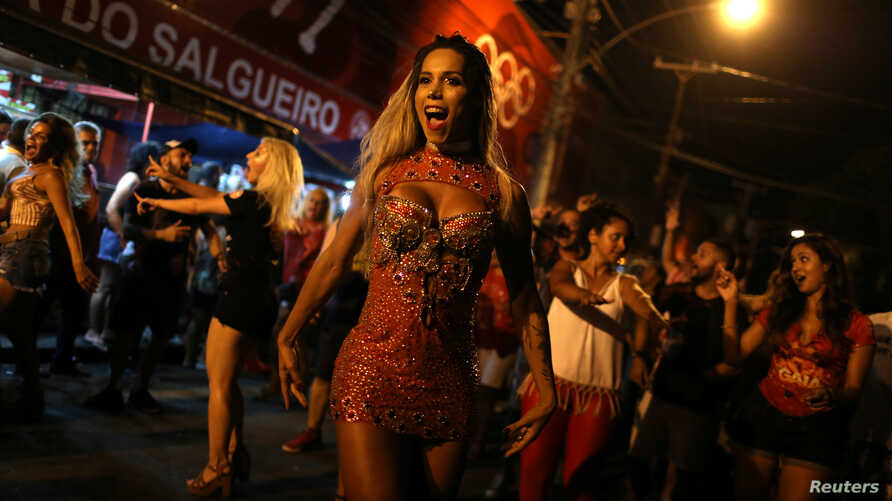 Transgender dancer Kamilla Carvalho performs during the rehearsal of Salgueiro samba school prior the carnival parade in Rio de Janeiro, Brazil, January 11, 2018.