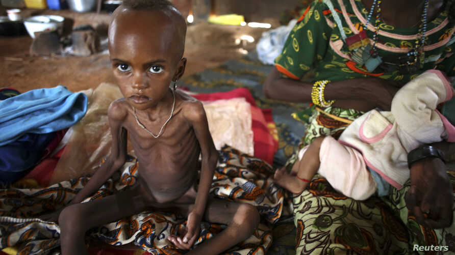 A sick internally displaced Muslim girl sits next to her mother in a house in the town of Boda, April 15, 2014.
