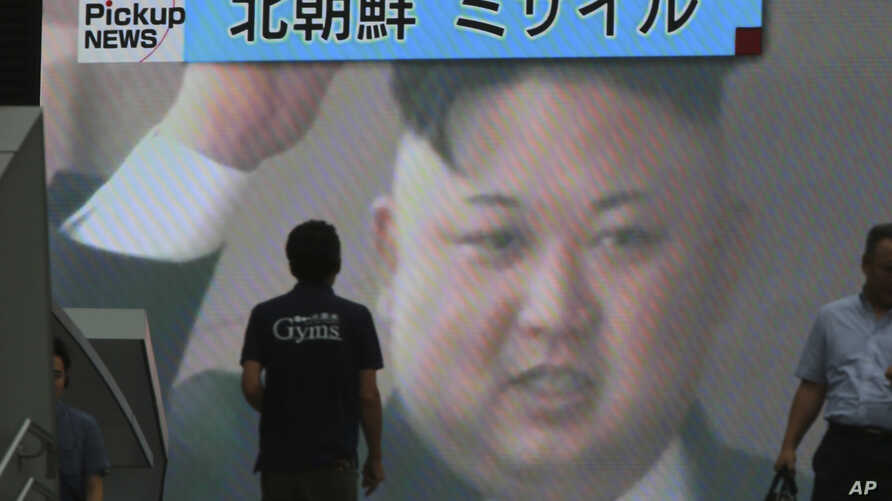 A TV news shows an image of North Korean leader Kim Jong Un while reporting North Korea's missile test which landed in the waters of Japan's economic zone in Tokyo, July 4, 2017.
