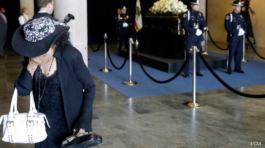 A woman cries after viewing the casket of Nancy Reagan at the Ronald Reagan Presidential Library, March 10, 2016, in Simi Valley, California.
