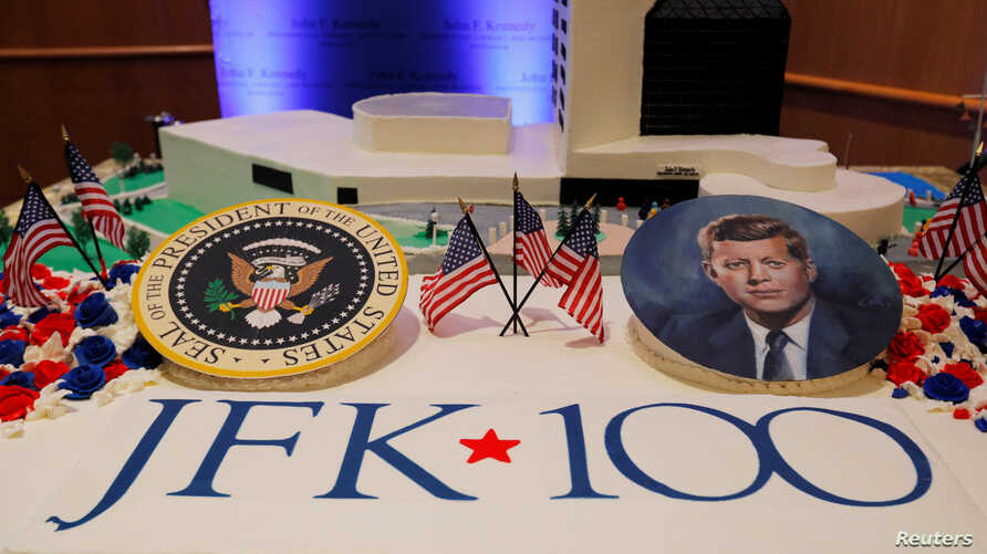 Workers display a large birthday cake on the 100th anniversary of the birth of President John F. Kennedy on May 29, 1917, at the John F. Kennedy Presidential Library in Boston, Massachusetts, U.S., May 29, 2017.