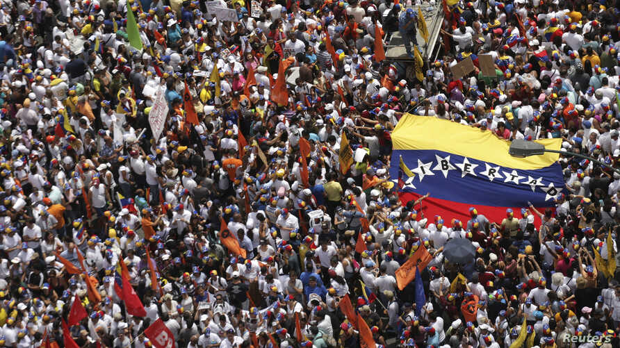 Opposition supporters march protest against Nicolas Maduro's government in Caracas February 22, 2014.