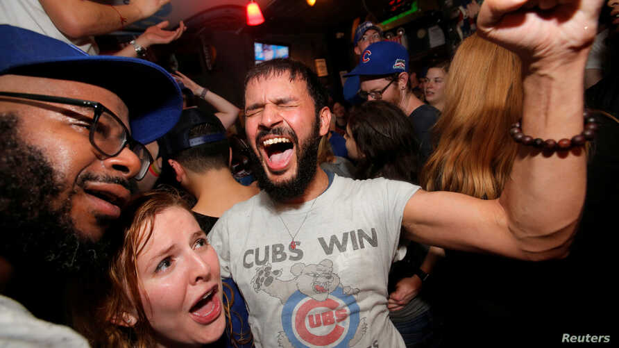 Fans of National League baseball team Chicago Cubs who gathered to watch the game at Kelly's bar celebrate their Major League Baseball World Series game 7 victory against American League's Cleveland Indians in Manhattan, New York, Nov. 3, 2016.