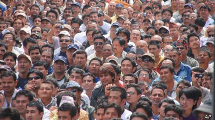 Faces in the crowd at the peace assembly in Kathmandu, 07 May 2010