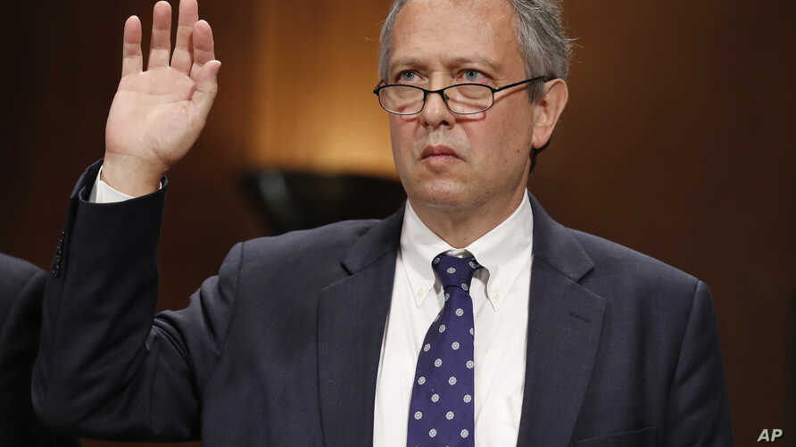 FILE - Thomas  Farr is sworn in during a Senate Judiciary Committee hearing, Sept. 20, 2017, on his nomination to be a district judge on the United States District Court for the Eastern District of North Carolina, on Capitol Hill in Washington.