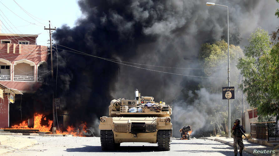 A military vehicle of the Iraqi army with Shi'ite Popular Mobilization Forces (PMF) is seen during a fight with the Islamic State militants in Tal Afar, Iraq August 26, 2017.