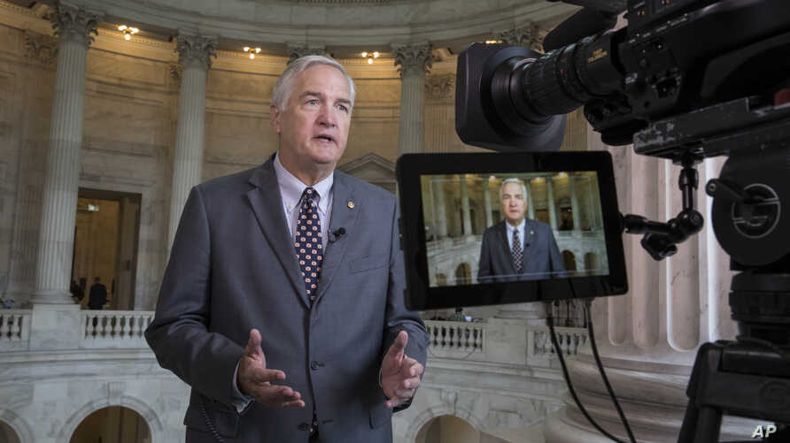 FILE - Sen. Luther Strange, R-Ala. responds to questions during a TV news interview on Capitol Hill in Washington, July 11, 2017.
