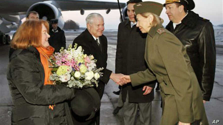 U.S. Defense Secretary Robert Gates, center, and his wife Becky, left, are greeted upon their arrival in St. Petersburg, Russia, March 21, 2011