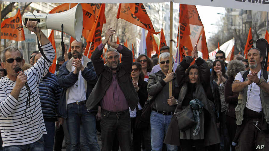Protesters chant anti-austerity slogans during a rally in the northern Greek port city of Thessaloniki, March 19, 2014.