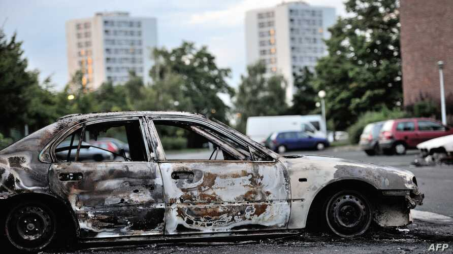 Damaged car sit in northern neighborhood of Amiens, France, August 15, 2012.