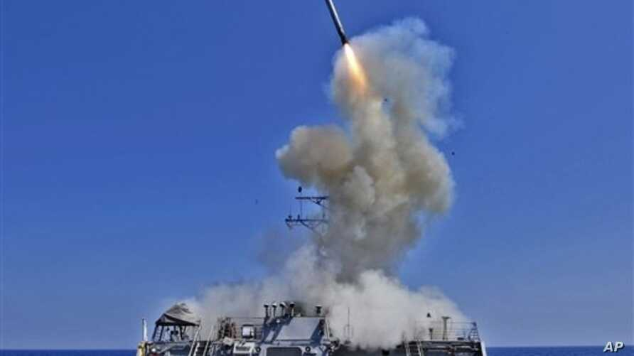 A Tomohawk cruise missile takes off from the USS Barry, one of four Navy destroyers positioned to take part in any U.S. attack on Syria.