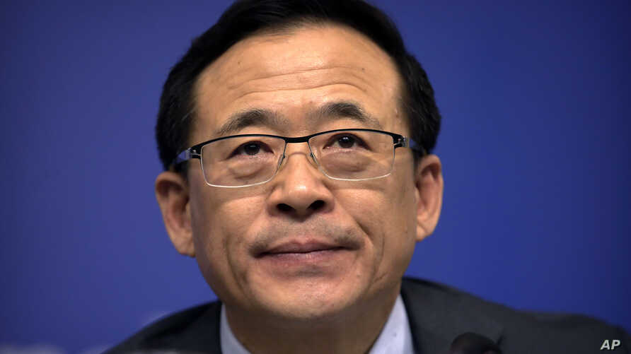 Liu Shiyu, chairman of the China Securities Regulatory Commission, pauses before the start of a press conference on the sidelines of the annual meeting of China's National People's Congress (NPC) in Beijing, March 12, 2016.
