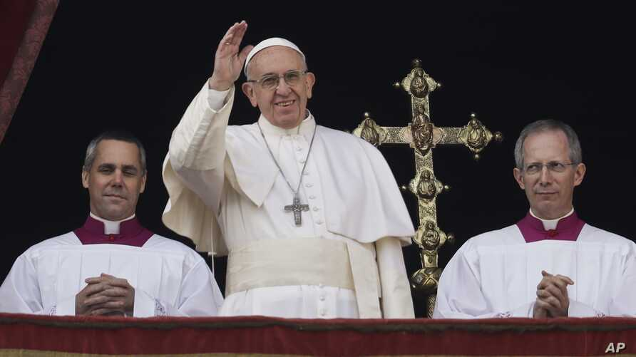 Pope Francis delivers the Urbi et Orbi (Latin for ' to the city and to the world' ) Christmas' day blessing from the main balcony of St. Peter's Basilica at the Vatican, Dec. 25, 2016.