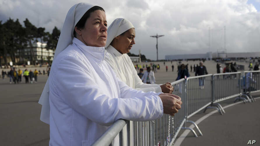 Two nuns attend a mass at the Chapel of the Apparitions in the Fatima Sanctuary, May 11, 2017.