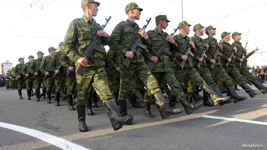 Pro-Russian rebels march during a rehearsal for the Victory Day military parade in Donetsk, Ukraine, May 5, 2015.