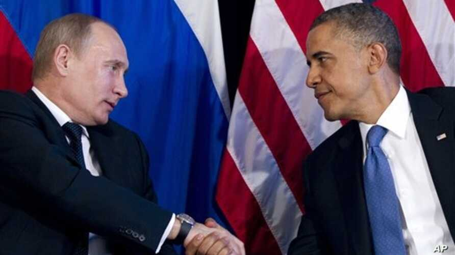 Presidents Barack Obama and Vladimir Putin, pictured here during a 2012 summit meeting, have been encouraging intelligence sharing since the Boston Maraton bombing.