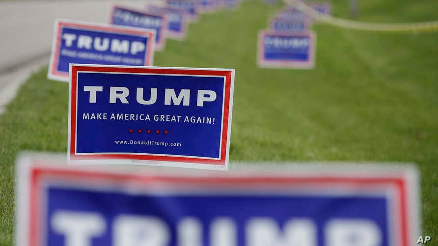 Republican presidential candidate Donald Trump signs are posted outside of the Allen County War Memorial Coliseum during a campaign stop, May 1, 2016, in Fort Wayne, Ind.