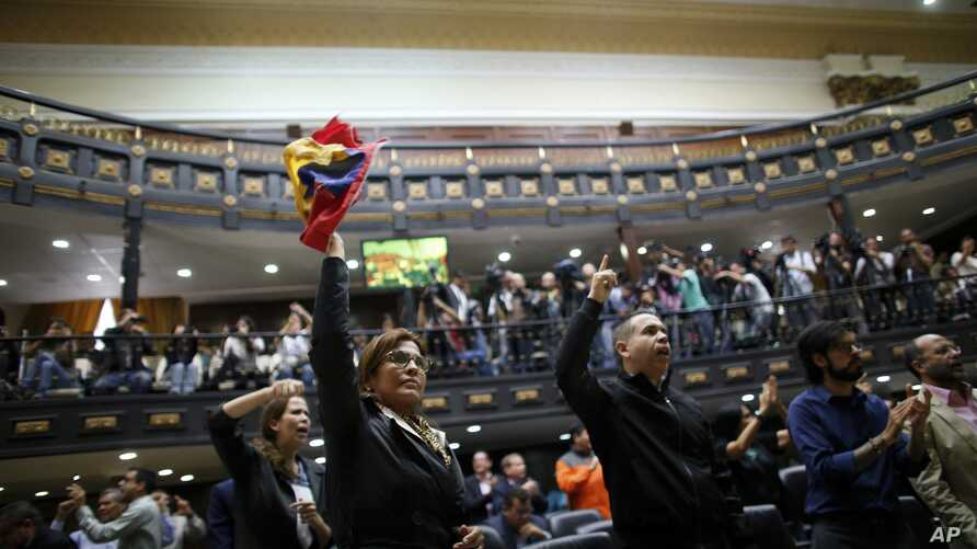 """Anti-government lawmakers shout """"Fraud,"""" during a session of Venezuela's National Assembly, in Caracas, Venezuela, Aug. 2, 2017."""