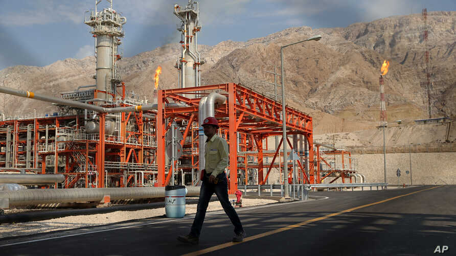 A worker makes his way in a natural gas refinery in the South Pars gas field in Asalouyeh, Iran, on the northern coast of Persian Gulf, Nov. 19, 2015.