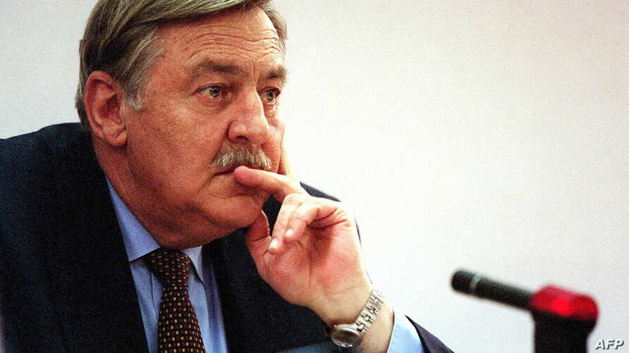FILE - Pik Botha, former South African foreign minister, listens to questions from members of the Truth and Reconciliation Commission in Johannesburg, Oct. 14, 1997. The apartheid-era South African foreign minister has died at the age of 86 in Pretor