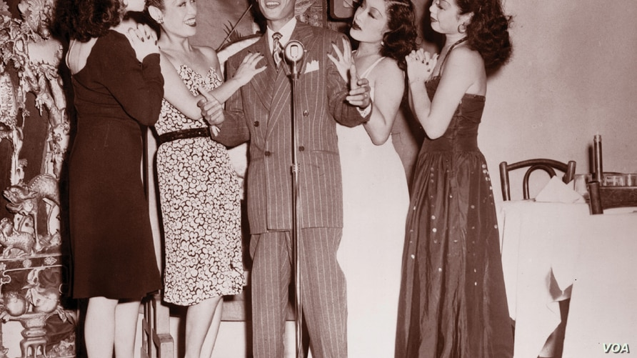 """Larry Ching, """"the Chinese Frank Sinatra,"""" with fellow performers at the Forbidden City nightclub in the early 1940s (Courtesy DeepFocus Productions, Inc.)."""