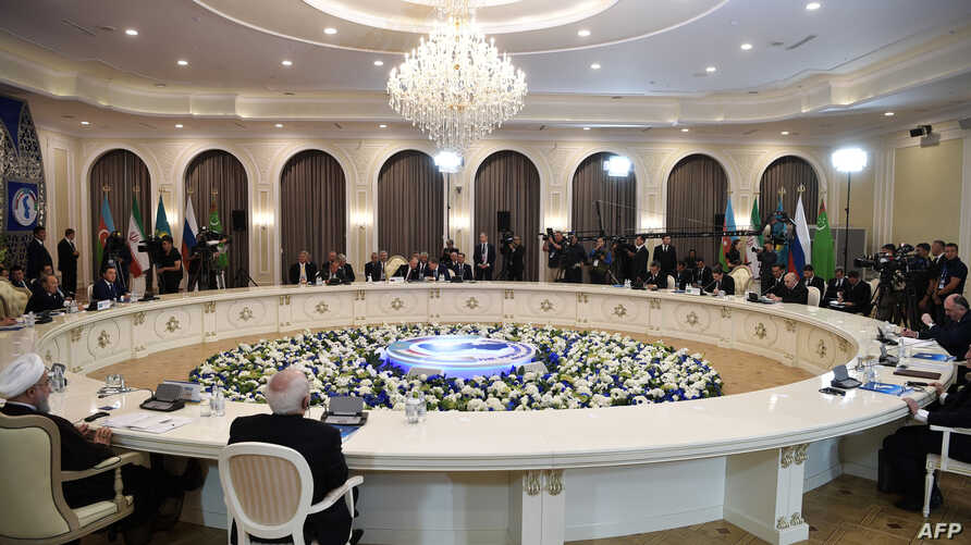 Heads of the Caspian region countries take part in a plenary session during the 5th Caspian Summit in Aktau, Aug. 12, 2018.