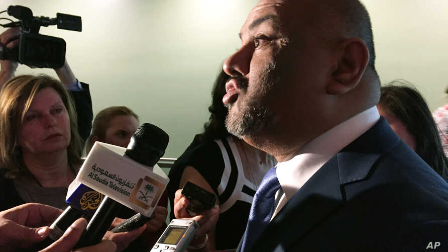 FILE - Yemen's U.N. ambassador, Khaled Alyemany, shown speaking to reporters in May, says the United Nations is expected to officially announce the date for Yemen peace talks soon.