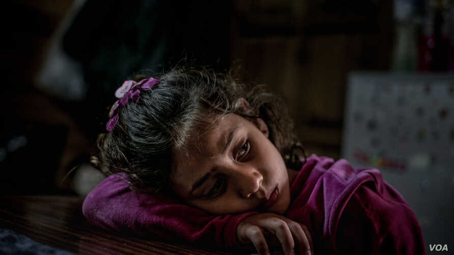 Mariem, 8, a refugee from the Syrian Arab Republic, in her family's shelter in Pikpa Village, an open refugee camp run by volunteers outside of Mytilini, Lesvos, Greece, Tuesday 14 March 2017. Mariem lives in the informal camp with her younger brothe