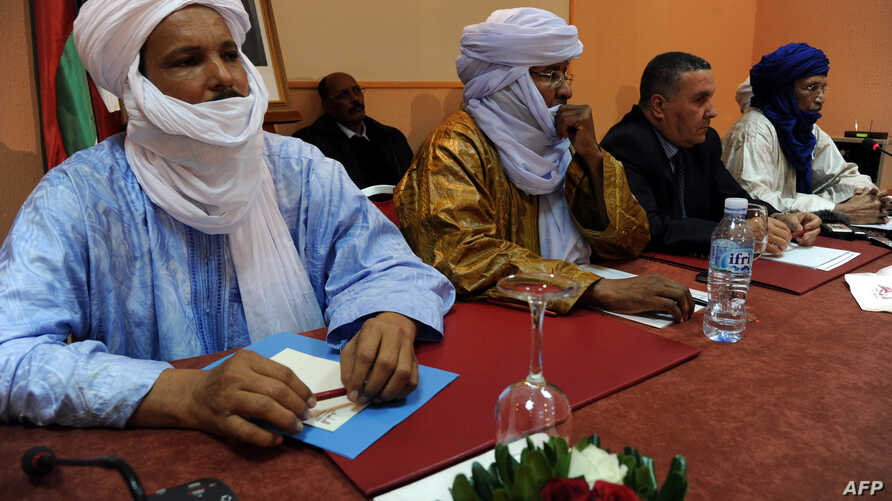Members of Ansar Dine and Tuareg National Movement for the Liberation of Azawad during a meeting in Algiers, Algeria, December 21, 2012.