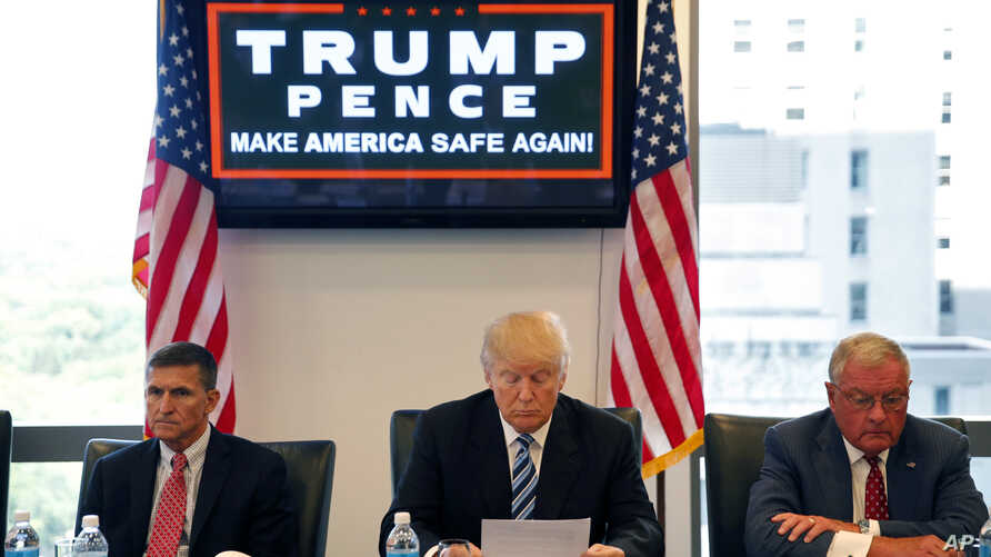 FILE - In this Aug. 17, 2016, photo, then-Republican presidential candidate Donald Trump participates in a roundtable discussion on national security in his offices in Trump Tower in New York.