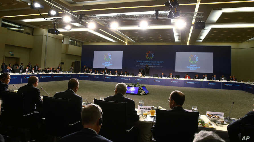 Participants take seats during the first World Humanitarian Summit in Istanbul, Monday, May 23, 2016.