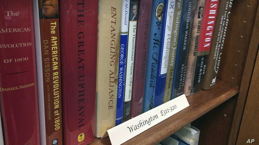 A row of books about President George Washington line a shelf at the New Hampshire Political Library at Saint Anselm College in Manchester, New Hampshire, June 9, 2017.